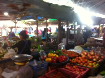 the market is a busy, blurry place.